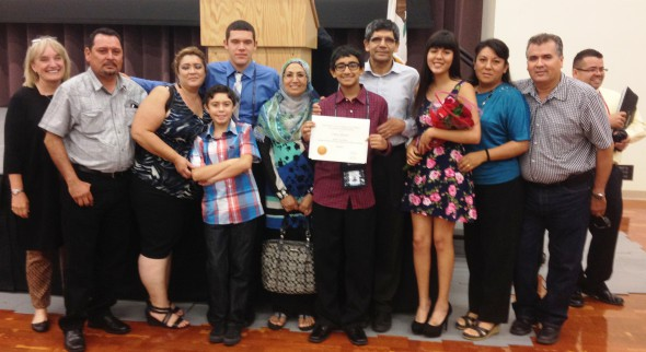 ON THEIR WAY: Academic Connections summer program participants Alejandro Quiroz (fifth from left), Omar Ahmad (holding certificate) and Cynthia Cortez (fourth from right) are shown during the welcoming reception for the recently concluded three-week program. Photo courtesy of Gretchen Laue