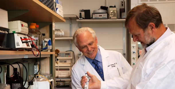 Dr. William Mobley confers with Dr. Pavel Belichenko, a close friend and UC San Diego colleague who passed away last year.